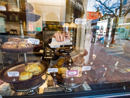 Amy Langford selects a baked treat for a customer at