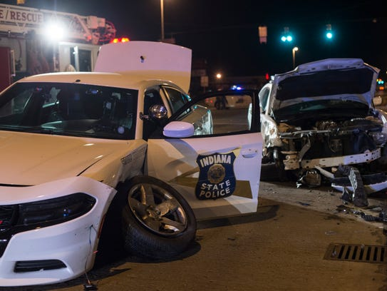 Two Indiana State Police vehicles crashed at the intersection