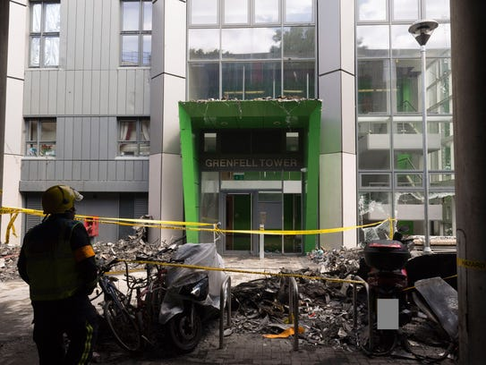 The entrance to Grenfell Tower shows little damage.