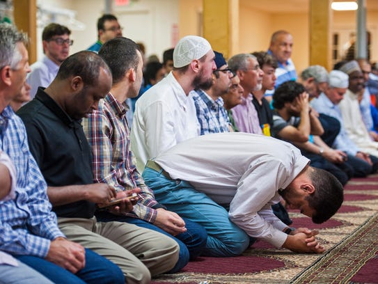 Congregants pray at the Islamic Society of Vermont
