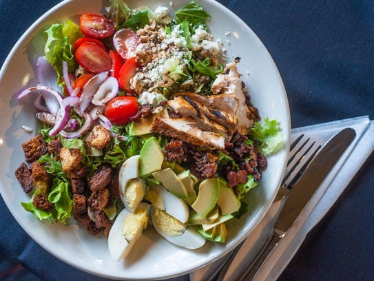A chopped salad with grilled chicken and avocado at