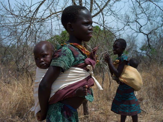 Children from South Sudan stand in scrub near the Bidi Bidi Refugee Camp in Uganda on Feb. 22, 2017.