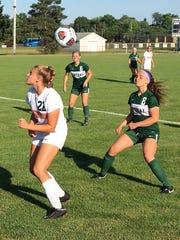 Brighton's Isabel Stropich (left) heads the soccer