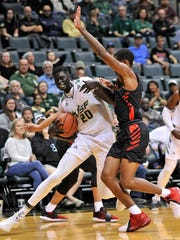 South Florida forward Mayan Kiir (20) drives to the rim during the first half of a game against Houston on Jan. 19, 2019 in Tampa, Fla. (AP Photo/Steve Nesius)