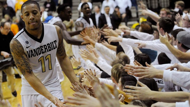 Vanderbilt Commodores guard Kyle Fuller (11) celebrates with the fans after the Commodores defeated Tennessee Volunteers 64-60 at Memorial Gym Wednesday, Feb. 5, 2014 in Nashville, TN.