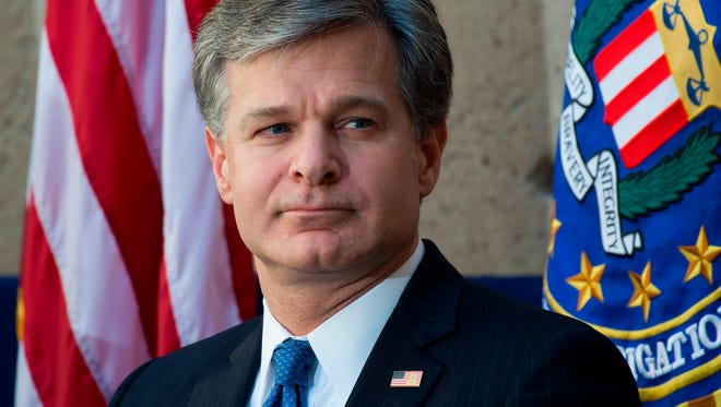 In this file photo taken on September 28, 2017 FBI Director Christopher Wray attends his installation ceremony as director at FBI Headquarters in Washington, DC. US President Donald Trump publicly attacked the FBI's leadership on February 2, 2018, accusing them of politicizing their investigations in favor of Democrats as he gets set to approve the release of an explosive memo alleging the agency's abuse of power. The extraordinary accusation is the latest salvo in the president's open conflict with the top US law enforcement agency amid an investigation into possible Trump campaign collusion with a Russian effort to sway the 2016 presidential elections.