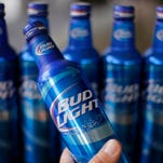 Aluminum bottles of Bud Light beer are on display at Alcoa headquarters in Pittsburgh in 2014. Anheuser-Busch is apologized Tuesday for a slogan that appeared on bottles saying Bud Light removes the word 'no' from drinkers' vocabulary.