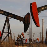 Pump jacks and wells are seen in an oil field where gas and oil extraction using hydraulic fracturing was on the verge of a boom in 2014.