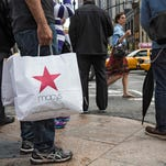 A shopper walks through Herald Square, outside Macy's on 34th Street in New York City.