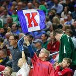 A Jayhawks fan waves a flag during the Kansas vs. Austin Peay NCAA men's basketball tournament first round game on Thursday, March 17, 2016, at Wells Fargo Arena in Des Moines.