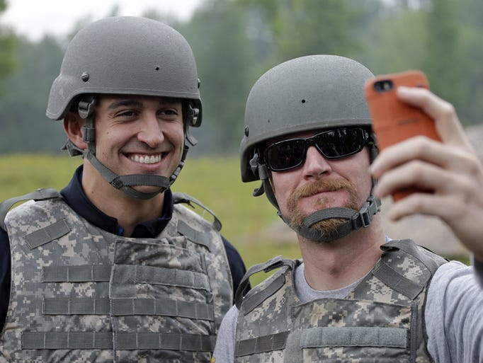 NASCAR driverDale Earnhardt Jr. takes a selfie of himself and IndyCar driverGraham Rahalat Camp Atterbury Wednesday, July 23, 2014, in Edinburgh, Ind. (AP Photo/Darron Cummings)