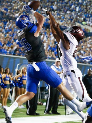 University of Memphis tight end Joey Magnifico (left) grabs  a touchdown pass while defended by Southern Illinois University safety Ryan Neal (right) during second quarter action at the Liberty Bowl Memorial Stadium Saturday, September 23, 2017.