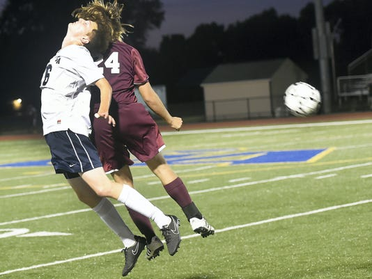 Ian Gelsinger, left, of Greencastle-Antrim, does a skim header against the defense of Braxton Shetter (24) of Shippensburg during G-A's 1-0 win Tuesday.