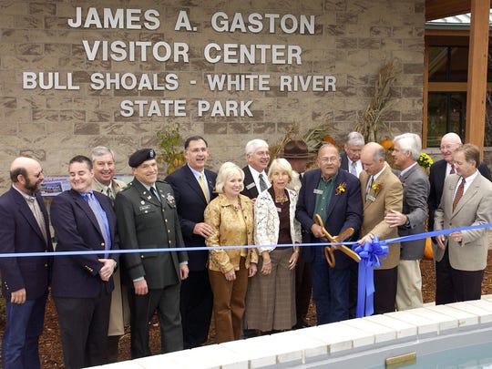 Jim Gaston cuts the ribbon during the dedication ceremony for the James A Gaston Visitor Center in Bull Shoals on Oct. 19, 2006. Gaston was a champion of tourism in the Twin Lakes Area and Arkansas for nearly 50 years.