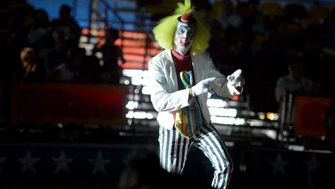 Circus performer Clown Chips, aka. Julius Carallo, performs for the crowd under the big top for Cole Brothers Circus at Augusta Expo in Fishersville on Tuesday, Sept. 2, 2014.