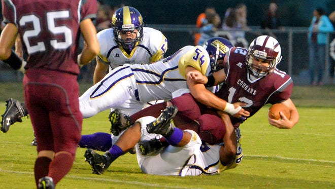 Waynesboro's Daniel Everidge gets in on the sack to bring down Stuarts Draft quarterback Caleb Dameron during the first half of a football game played in Stuarts Draft on Friday, Sept. 12, 2014.