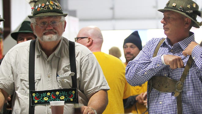 """""""Tuba"""" Dan Jerabek from Ripon and Mike Davis gather drinks at the counter at the Fifth Annual Oktoberfest Saturday"""