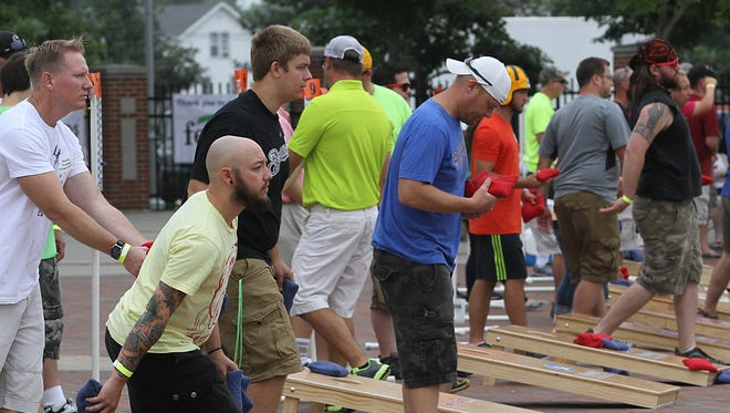 The 2014 Midwest Cornhole Championship was held at the Leach Amphitheater in Oshkosh.
