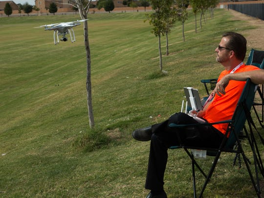 Robert Paquette, demonstrates how he can fly his drone by sight, not using the iPad camera screen, before taking the drone up over the Field of Dreams, Friday October 28, 2016.