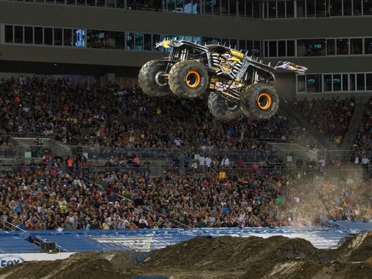 MAX-D does a high-flying freestyle stunt. The truck