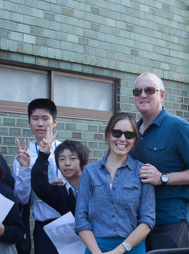 The Hugheys have done numerous interviews with Japanese school children hoping to practice their English. Here, they pose with one group from Kyoto.