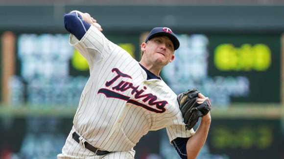 Twins starting pitcher Kevin Correia pitches in the fifth inning Aug. 6, 2014 against the San Diego Padres at Target Field. Correia signed a big league deal with the Phillies on Monday. Credit: Brad Rempel-USA TODAY Sports