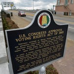 Mike Stewart/APA national historical marker stands at the Edmund Pettus Bridge in in Selma, Ala. A national historical marker is seen with the Edmund Pettus Bridge in the background , Tuesday, March 3, 2015, in Selma, Ala. A billboard (not seen) near the Edmund Pettus Bridge in Selma, Alabama, bears an image of Confederate general and Ku Klux Klan founder Nathan Bedford Forrest. The ad put up days ago by a group dedicated to honoring Forrest invites visitors to see Selmaâ??s â??War Between the Statesâ? historic sites,(AP Photo/Mike Stewart)