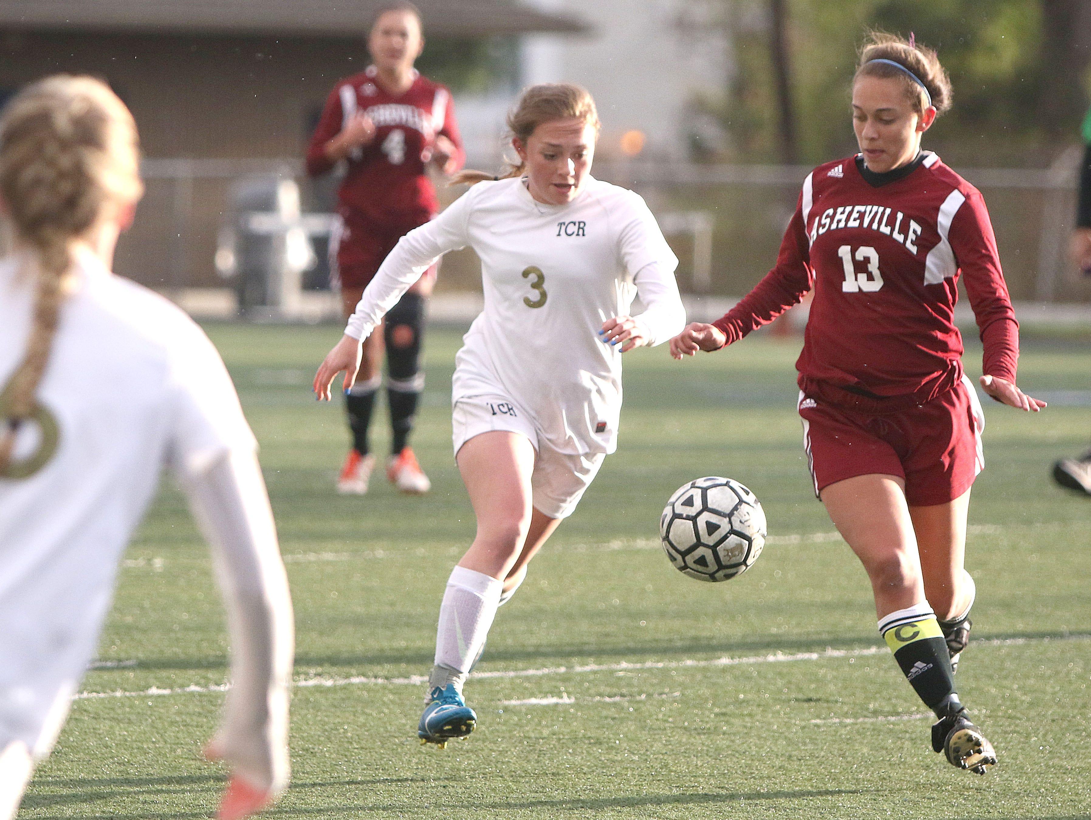 Roberson's Lauren Croft (3) and Asheville High's Kaileigh Mora (13).