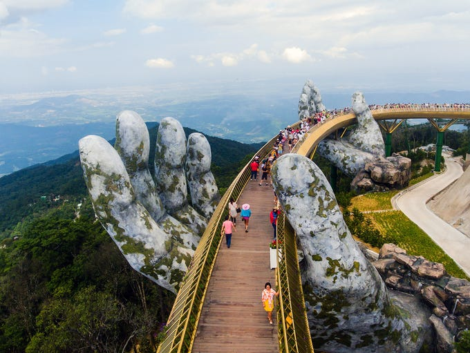 Tourists walking on the newly built Cau Vang, meaning
