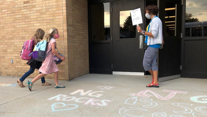 New Groningen Special Education Paraprofesional Dawn Ward greets students back to class Tuesday, Sept. 1. Tuesday was the first day of school for Zeeland Public Schools.