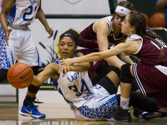 North Central's Auriel Wilson, left,  fights for a loose ball against Merryville's  Alyssa Duncan and others in the Allstate Sugar Bowl/LHSAA GirlsÕ Top 28 Basketball Tournament in Hammond March 3, 2016.