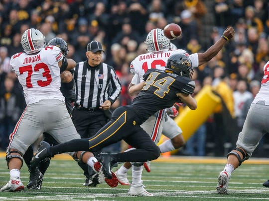 Iowa linebacker Ben Niemann sacks Ohio State quarterback