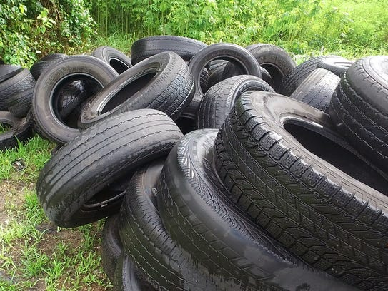 This tire pile is full of water as it sits on an empty