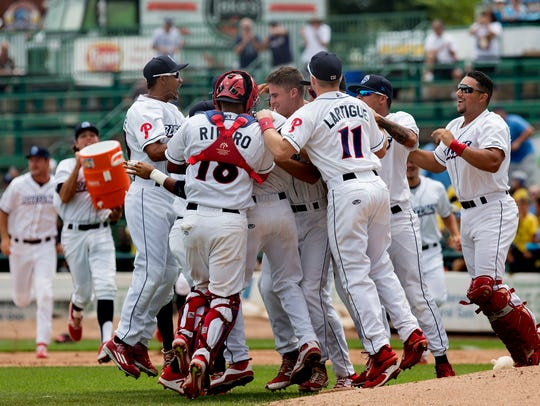 Nick Fanti is mobbed by teammates after pitching a