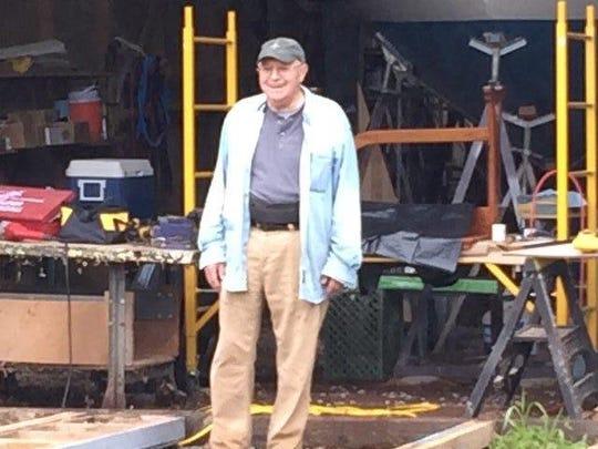 Dan Beltram stands in front of ther weatherproof structure