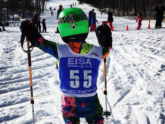 Charlie Brown, 3, in the threadbare ski racing suit that for 30 years has been worn and swapped at Cochran's annual Ski & Ride Sale. The suit has been worn by three U.S. Ski Team members and one Olympian, among others.