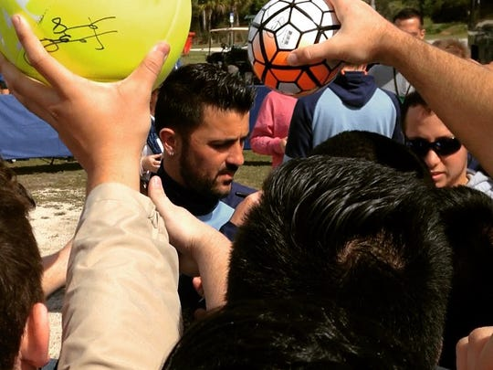 David Villa of the NYCFC signs autographs for fans on Friday at FGCU. The club is playing against FGCU on Sunday.