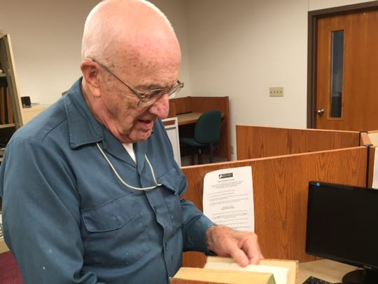 """Alan Megaw, 86, looks at a copy of """"The Terrible Siren,'' an early biography of Victoria Woodhull, the first woman to run for president. Megaw read the book in the 1930s at the Homer, Ohio, Public Library when he was visiting his grandparents' farm. Woodhull was born in Homer in 1838."""