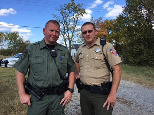 Lt. Kenneth Barrett, left, and Deputy Nick Coble were not harmed after allegedly being shot at by a convicted felon they were trying to arrest Tuesday.