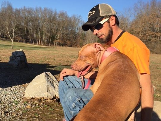 Jason Handy with dog Harley. Harley died after a spay