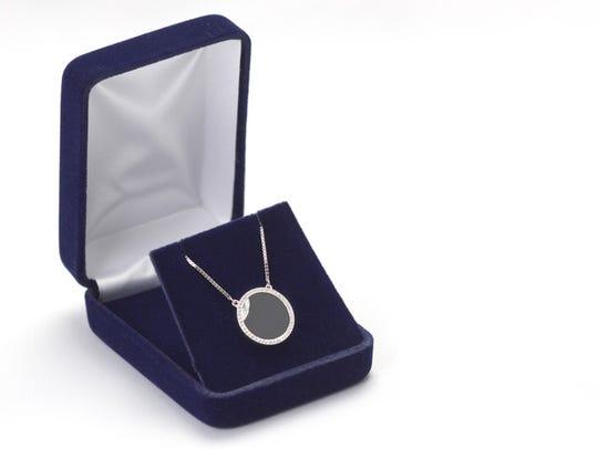 This custom-designed commemorative eclipse pendant