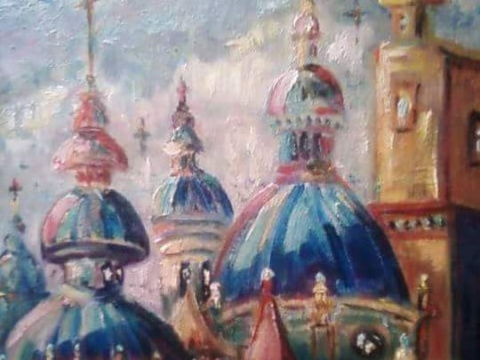 Vivid colors and Southwest flare are created in this oil painting of churches by Kathleen Cotton