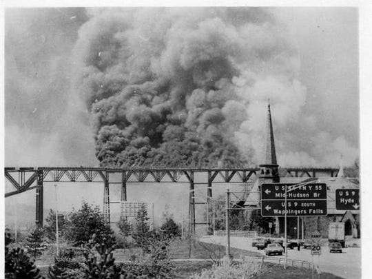 Smoke billows from the Poughkeepsie Railroad Bridge on May 8, 1974, which led to a fire that knocked the bridge out of commission for decades.