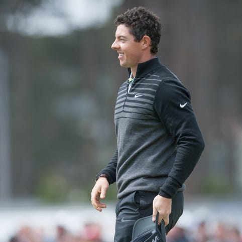 Rory McIlroy smiles after defeating Jim Furyk (not pictured) at the 18th hole during the World Golf Championships-Cadillac Match Play at TPC Harding Park.