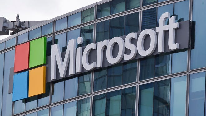 This Tuesday, April 12, 2016 file photo shows the Microsoft logo in Issy- les-Moulineaux, outside Paris, France.