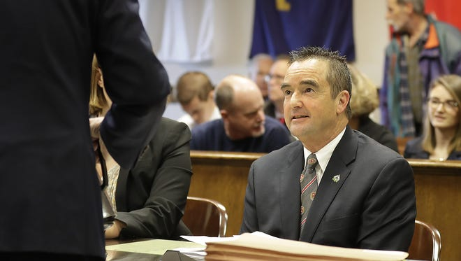 Green Bay Mayor Jim Schmitt sits in court at the Brown County Courthouse before pleading guilty to campaign finance irregularities Monday, December 5, 2016.