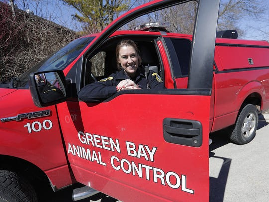 Green Bay Animal Control and Police Officer Mallory Meves poses with her work truck at the Bay Beach Wildlife Sanctuary in Green Bay,