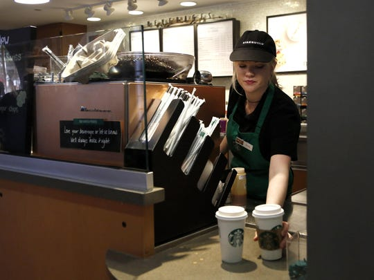 A Starbucks barista at the Warner Brothers Studio lot in Burbank, Calif., in February 2017. California coffee purveyors probably will have to use warning labels after a Los Angeles judge ruled that they failed to prove they should be exempt from a state law on carcinogens and toxic chemicals.