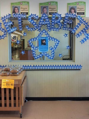 Make-A-Wish donation stars hang in an Associated Foods store during the 2014 Make-A-Wish fundraising campaign in which the grocery chain raised over $72,000 for Make-A-Wish Utah.