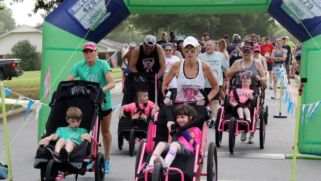 Led by Ainsley's Angels of America, more than 150 walkers and runners start the Manes & Miracles Raise the Barn 5K and 10K Run/Walk, Saturday, June 27, 2020, through the Fianna Hills neighborhood. The fundraiser brought in over $20,000 for the nonprofit and will benefit the equine-assisted therapy program in Barling. Manes & Miracles helps those with a wide variety of disabilities, providing both emotional and physical therapy for both adult and children patients.